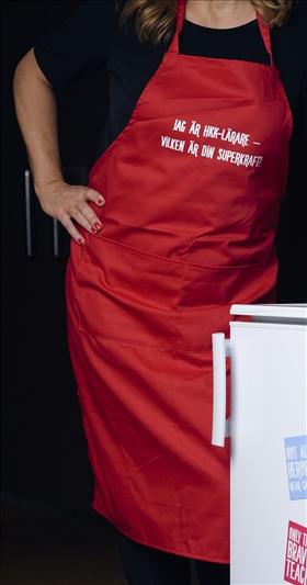 Förkläde: Jag är HKK-lärare – vad är din superkraft? (rött)